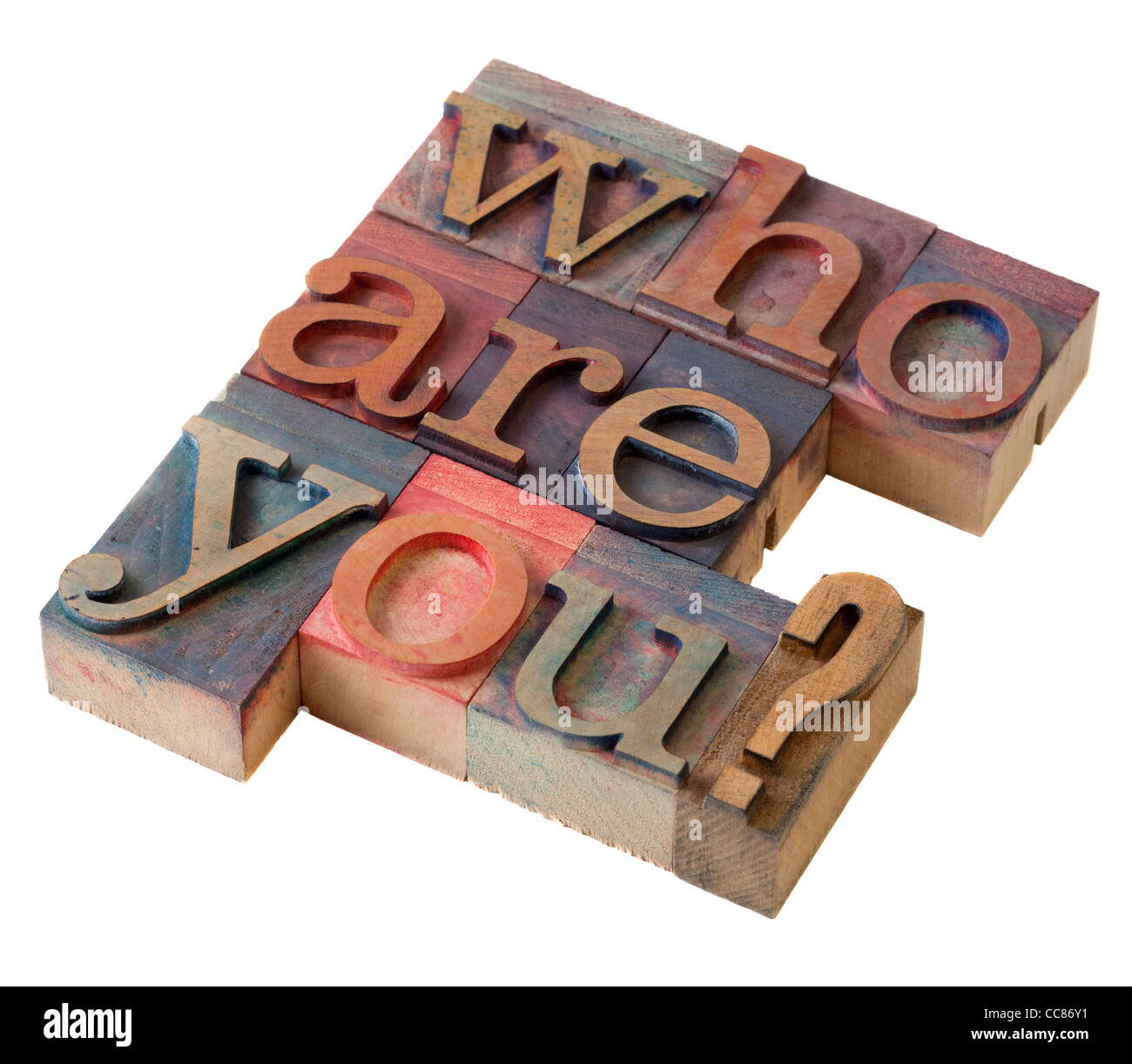 Who are you question in vintage letterpress printing blocks, stained by color inks, isolated on white - Stock Image