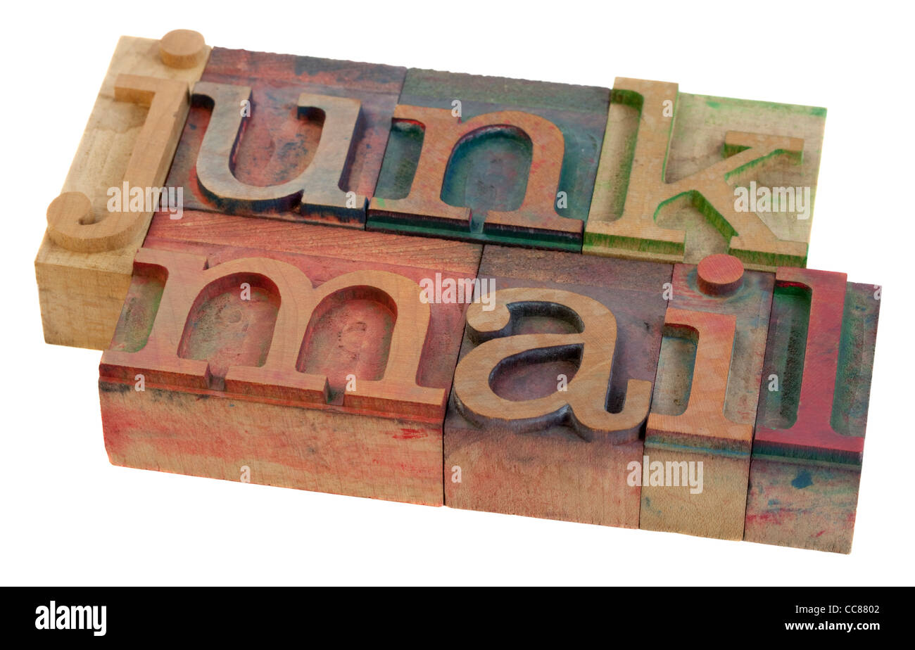junk mail - words in vintage letterpress printing blocks, stained by color inks, isolated on white - Stock Image