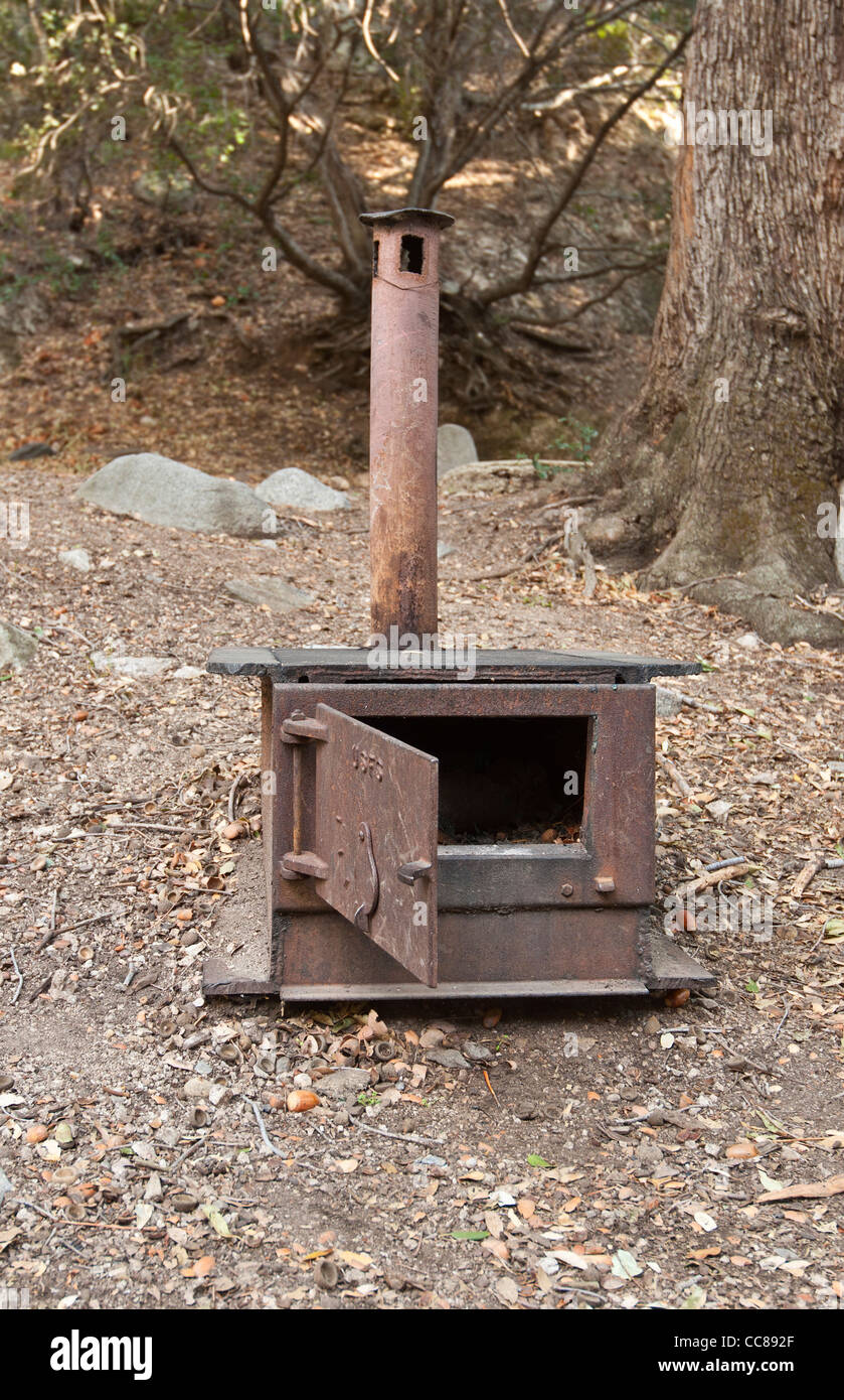 A very old camping stove found on a hiking trail in the Angeles National Forest, California. - Stock Image