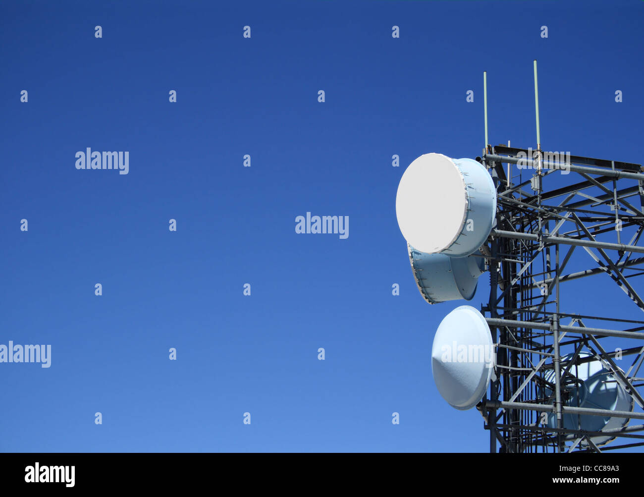 microwave antenna tower with plenty of blue sky copy space to the side Stock Photo