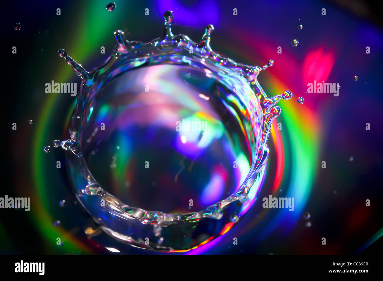 A colourful water droplet - Stock Image