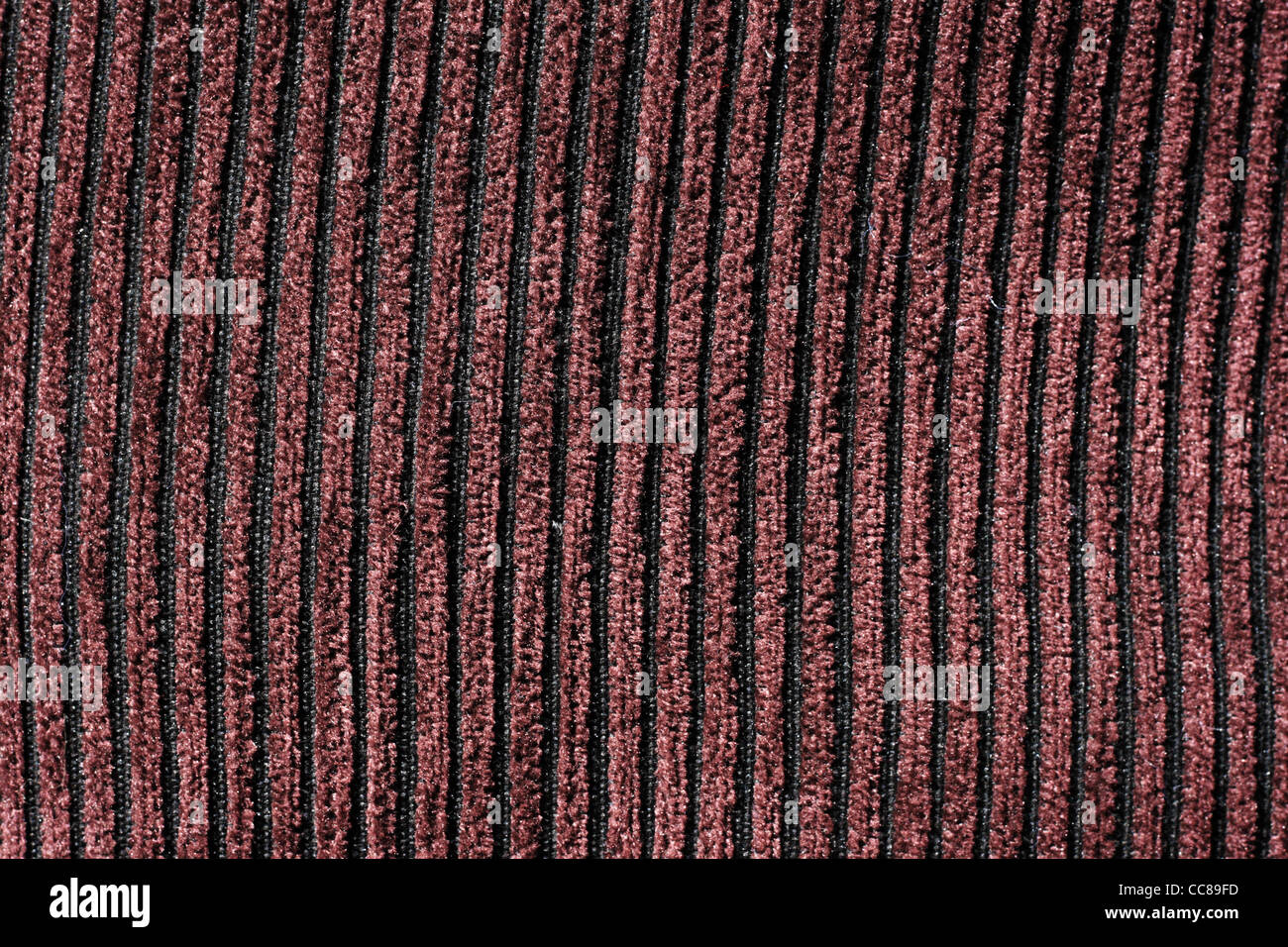 brown and black wide wale corduroy background - Stock Image