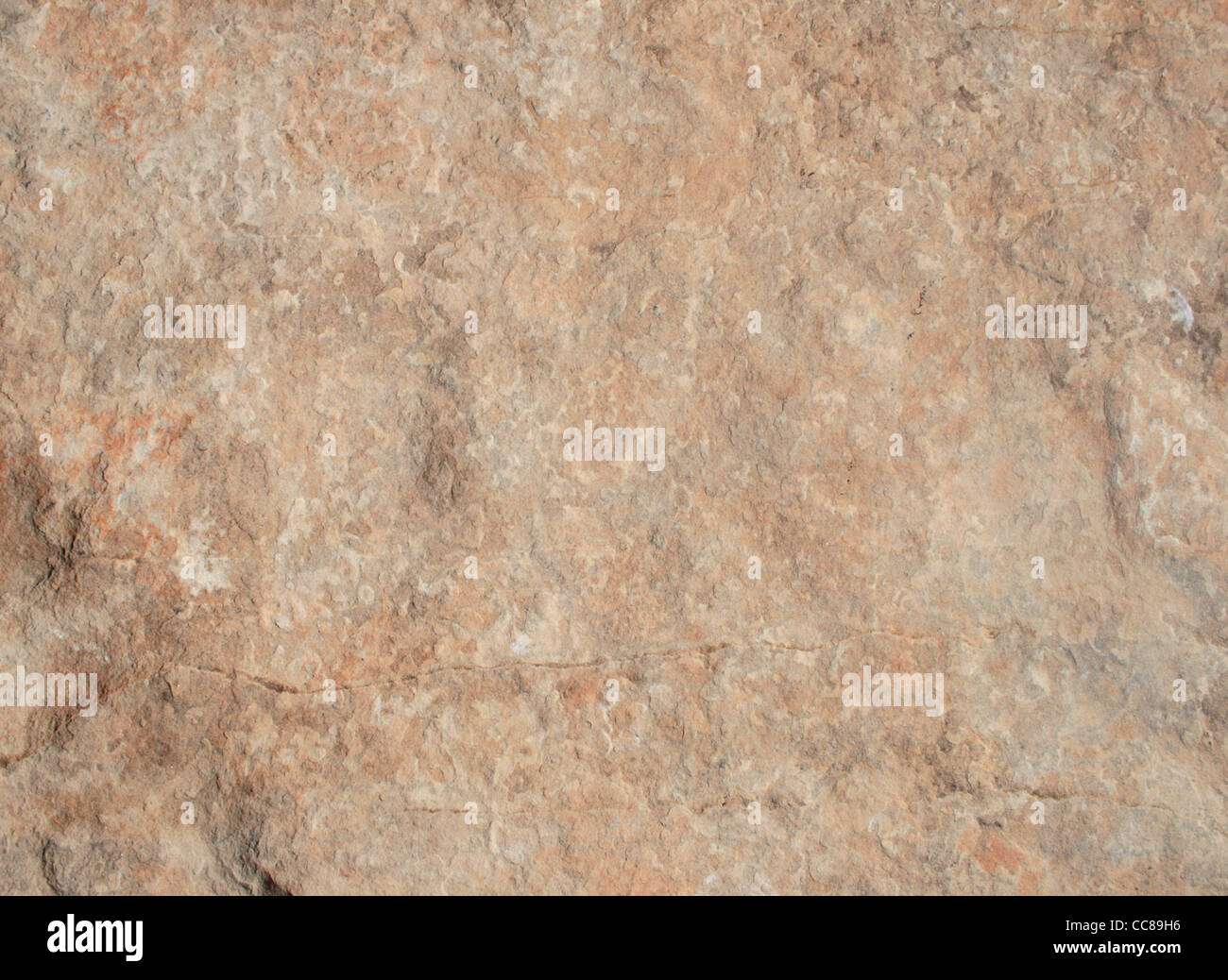 mottled sandstone background surface with interesting texture - Stock Image