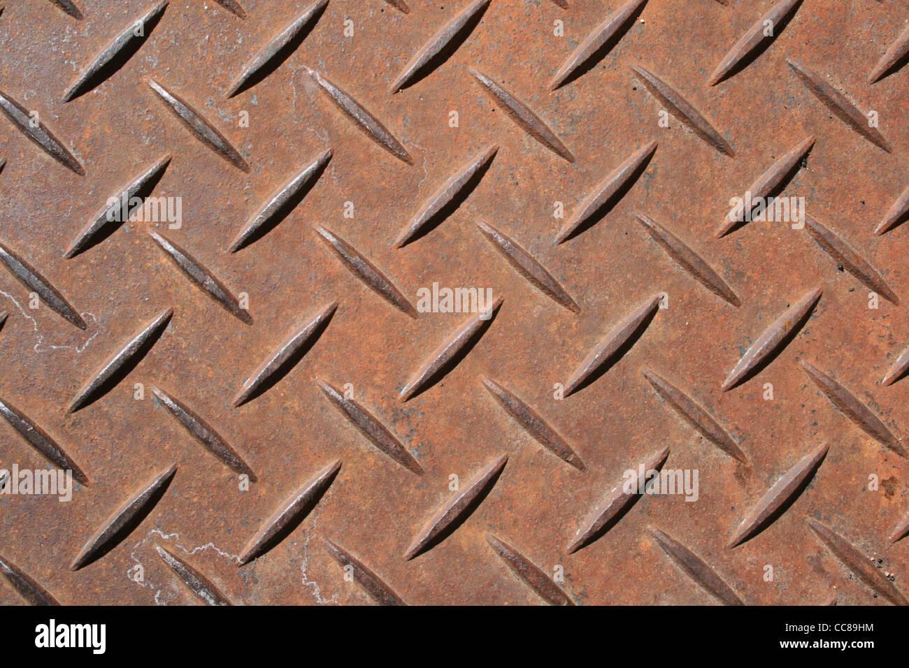 raised diamond pattern rusted steel panel - Stock Image