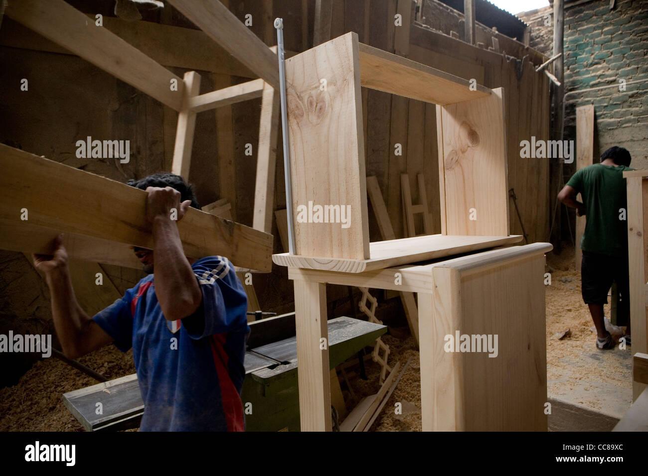 A Carpenter Works In A Woodworking Shop In Lima Peru South America Stock Photo Alamy