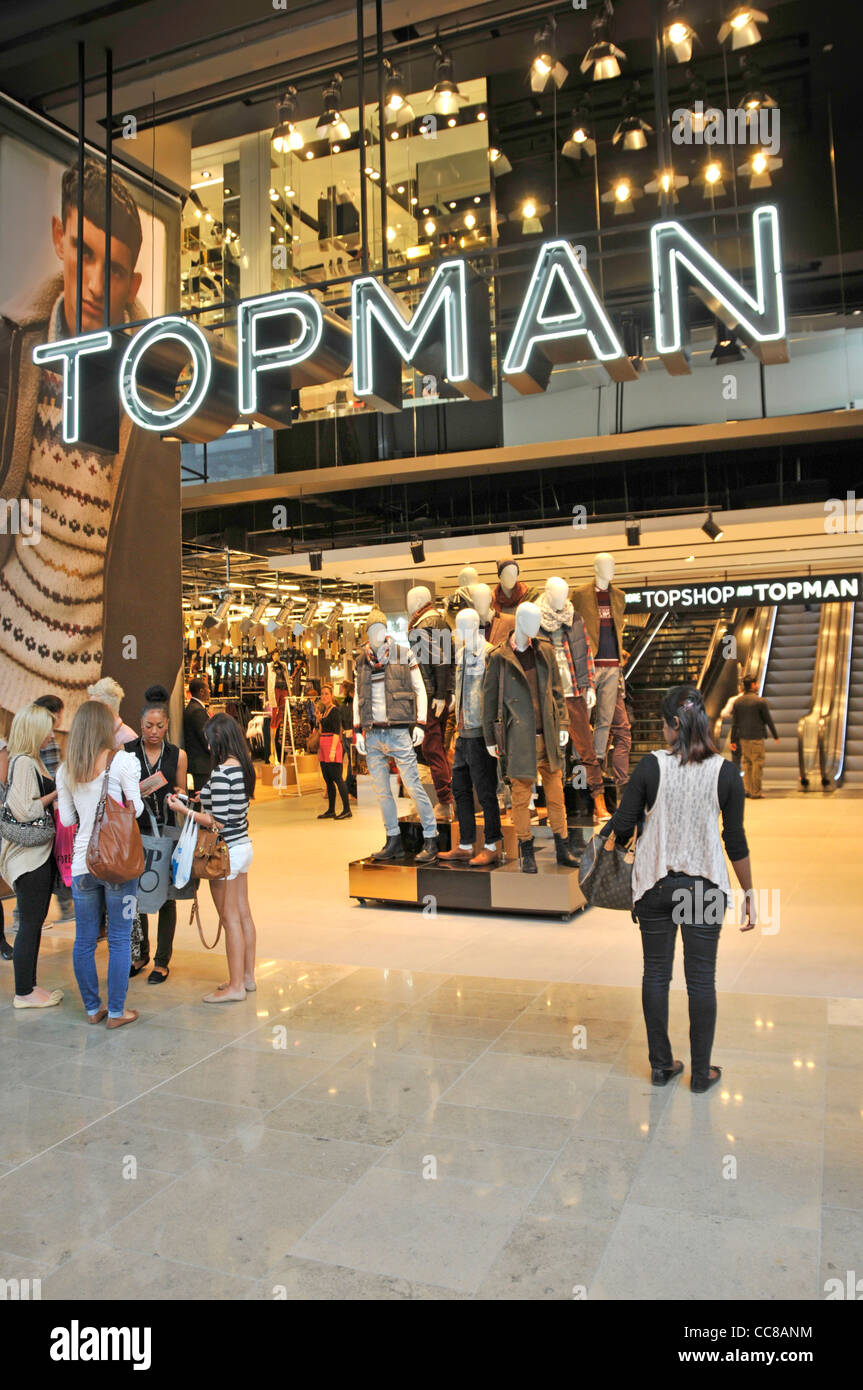 Wide walk in entrance to Topman store in the indoor shopping malls at Westfield shopping centre Stratford City Newham Stock Photo