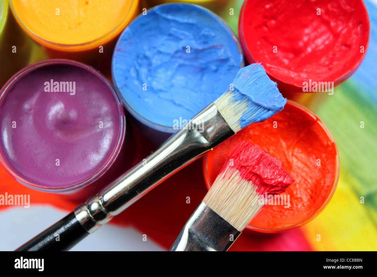 Paint brushes on opened paint bucket - Stock Image
