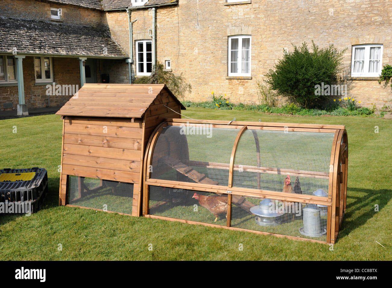 A chicken hutch in a Cotswold cottage garden UK - Stock Image