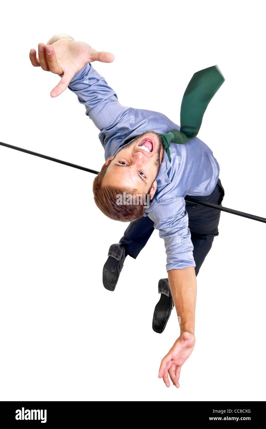 Businessman jumping over an Olympic high-jump bar - Stock Image