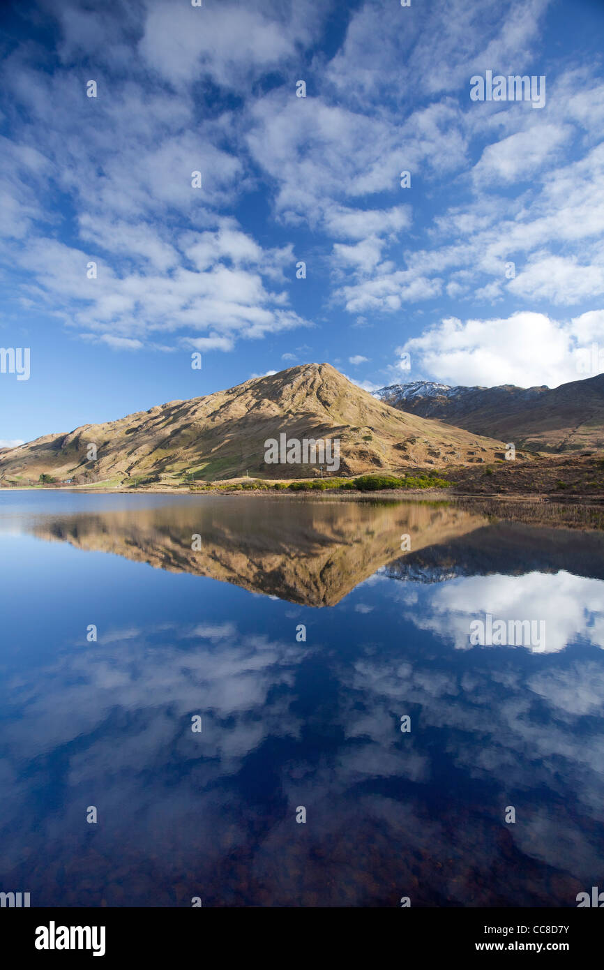 Reflection of Benbaun Mountain in Kylemore Lough, Connemara, County Galway, Ireland. - Stock Image