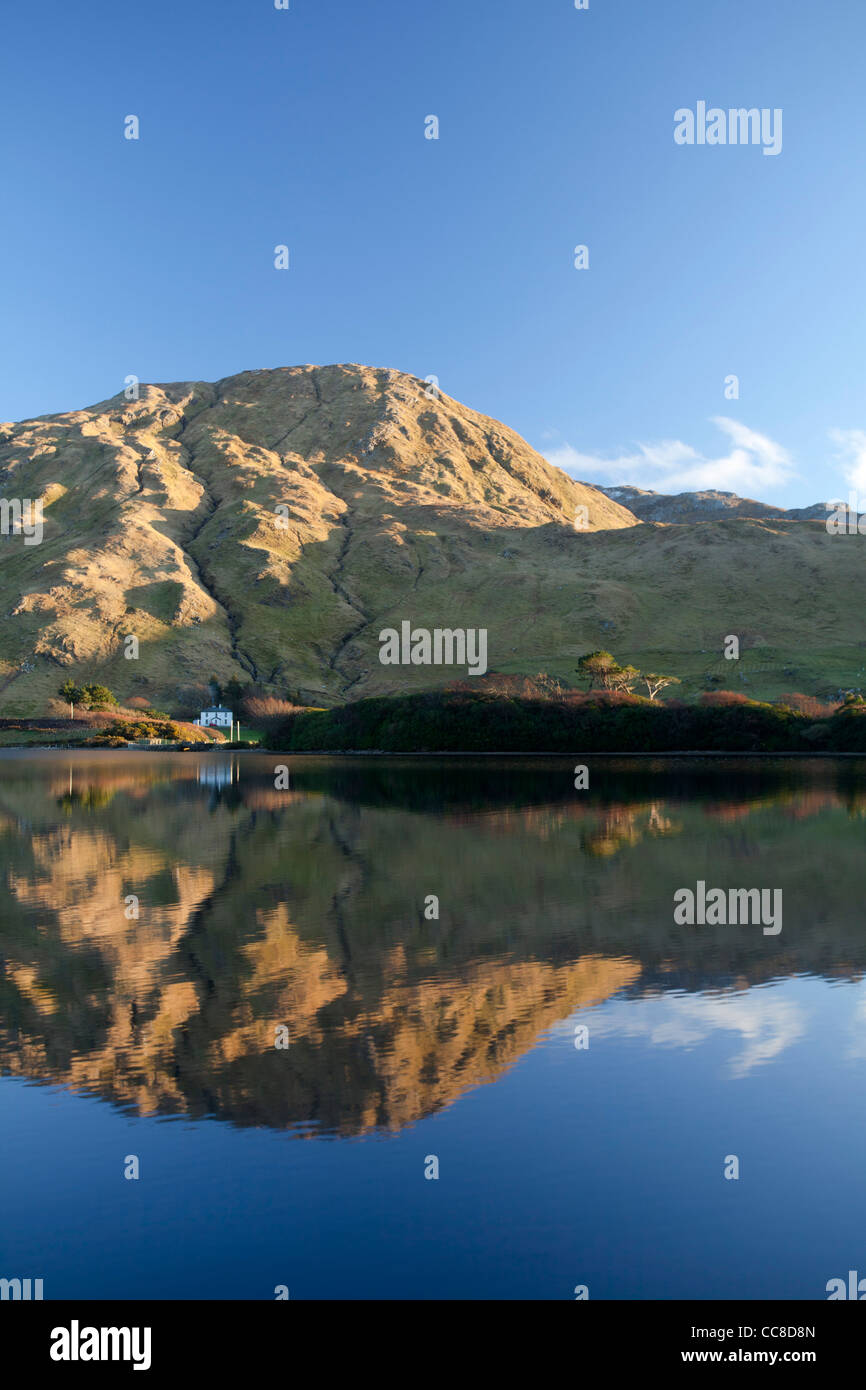 Evening reflection of the Twelve Bens Mountains in Kylemore Lough, Connemara, County Galway, Ireland. - Stock Image