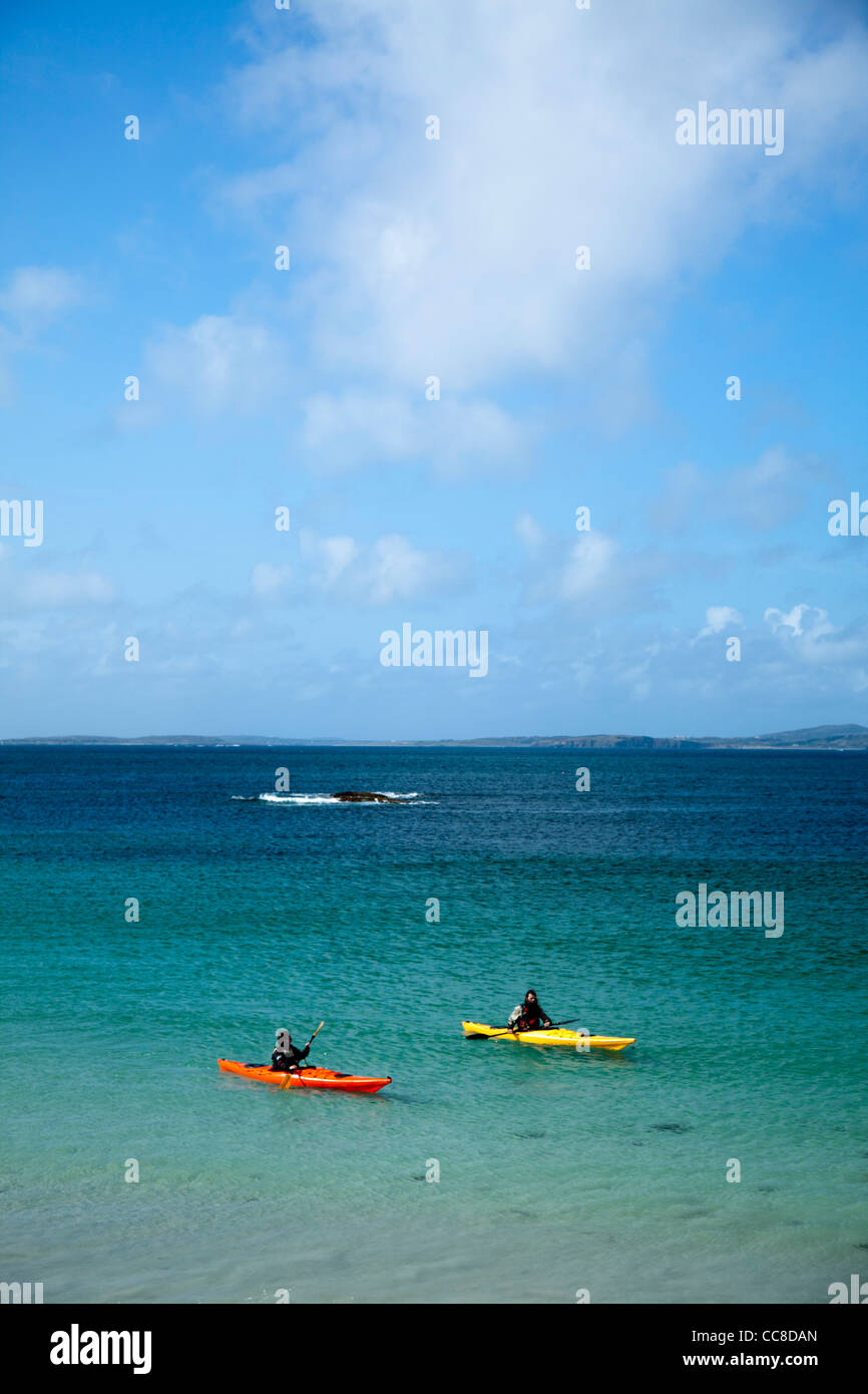 Sea kayakers in Mannin Bay, Connemara, County Galway, Ireland. - Stock Image