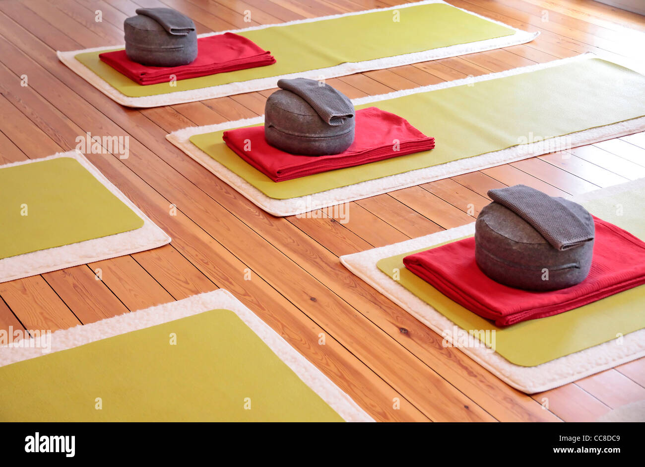 Close-up of yoga mats and yoga cushion in a yoga studio - Stock Image