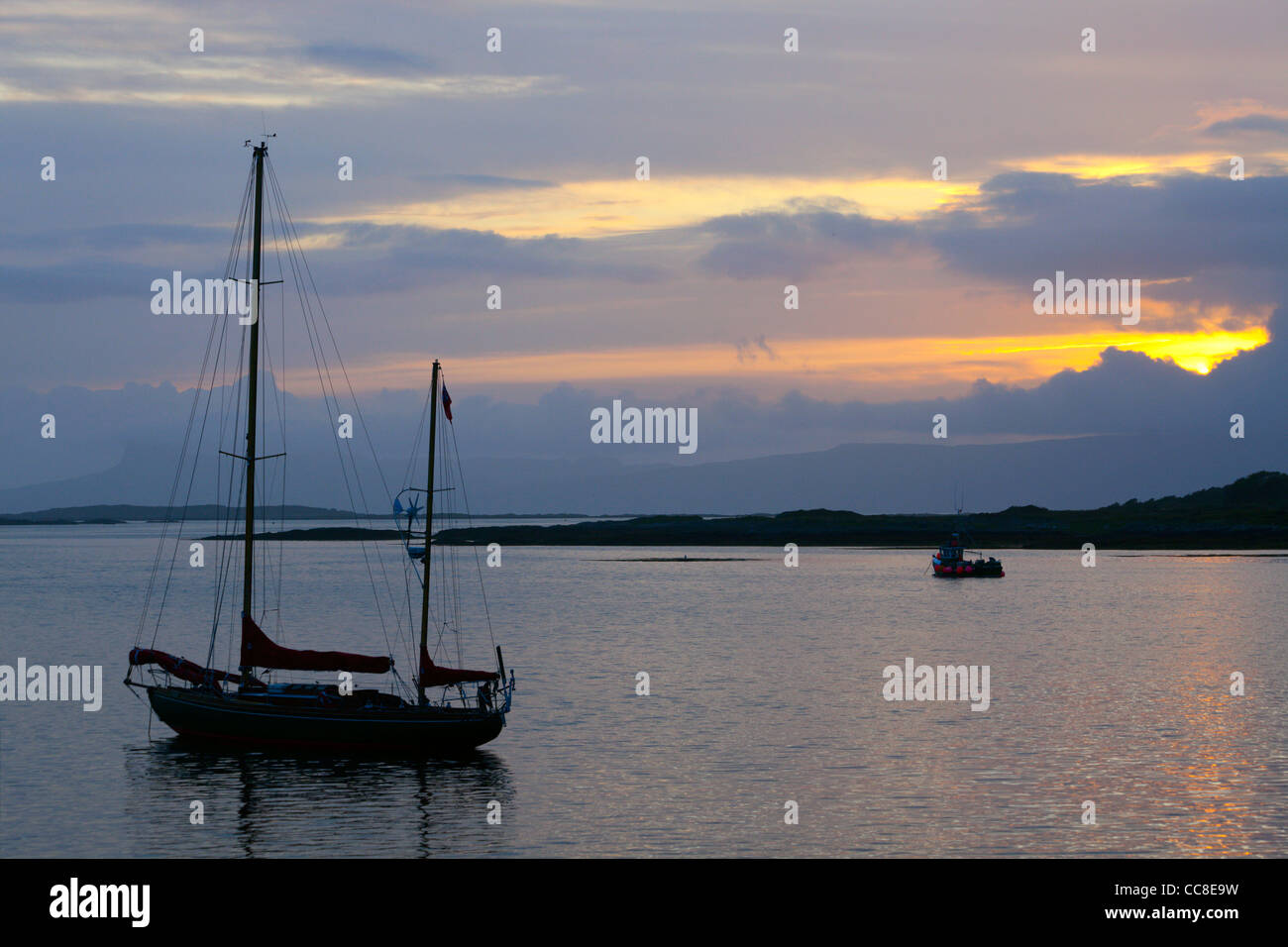 Ketch moored in Arisaig Harbour at dusk Highland Region Scotland - Stock Image