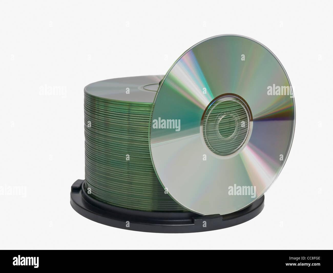 Detailansicht einer CD-Spindel, dabei steht eine CD   Detail photo of a CD-pack, one CD is upright Stock Photo