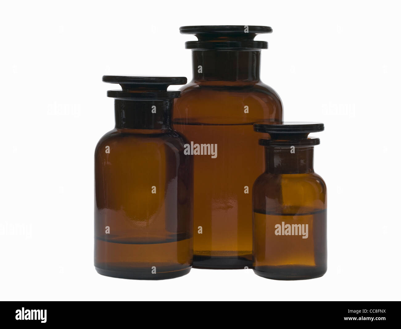Detail photo of three closed pharmacists bottles - Stock Image