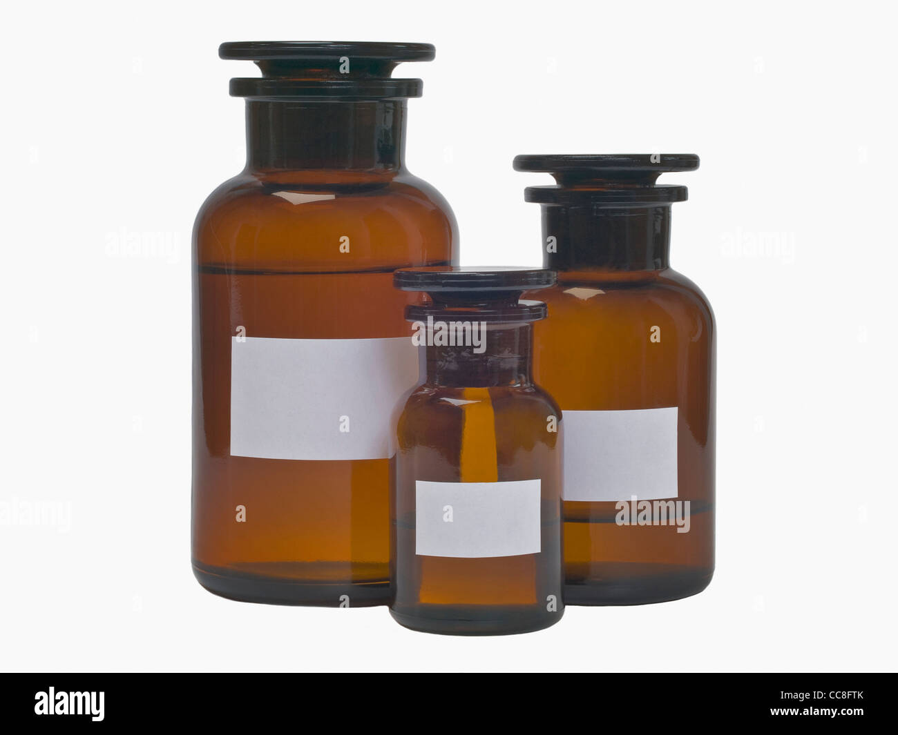 Detail photo of three pharmacists bottles - Stock Image