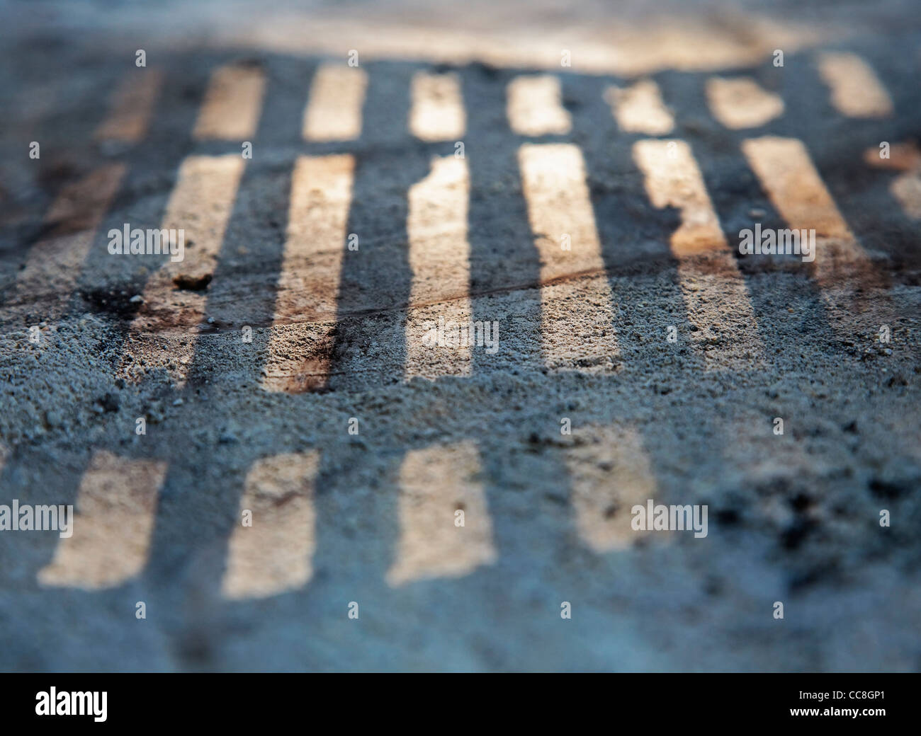 abstract detail of grill shadow on coal powder - Stock Image