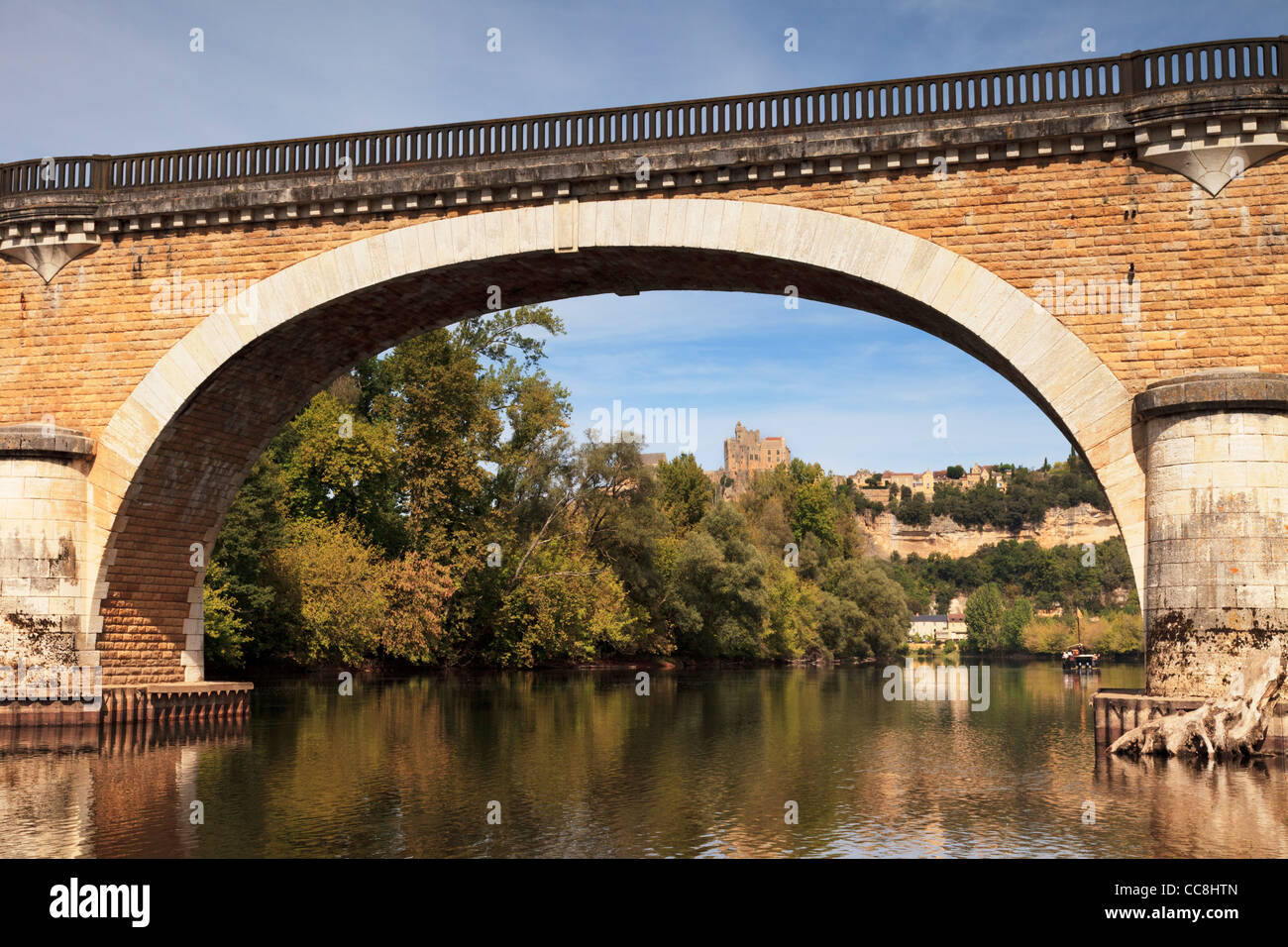 Beautiful old bridge on the River Dordogne at Beynac-et-Cazenac, Limousin, France, on a summer afternoon. - Stock Image
