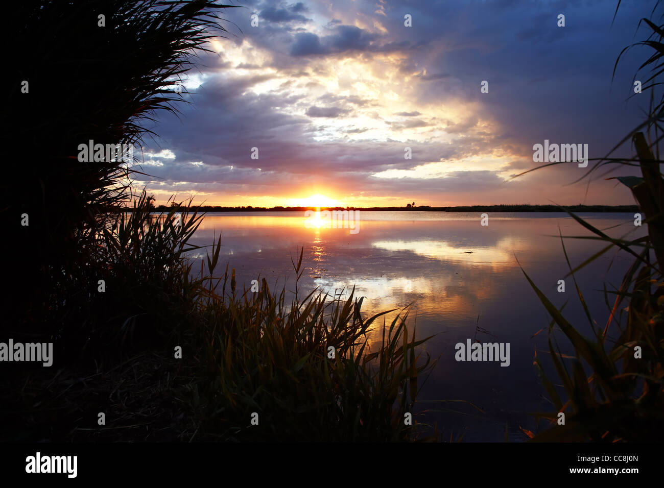 Sunrise on like and clouds - Stock Image
