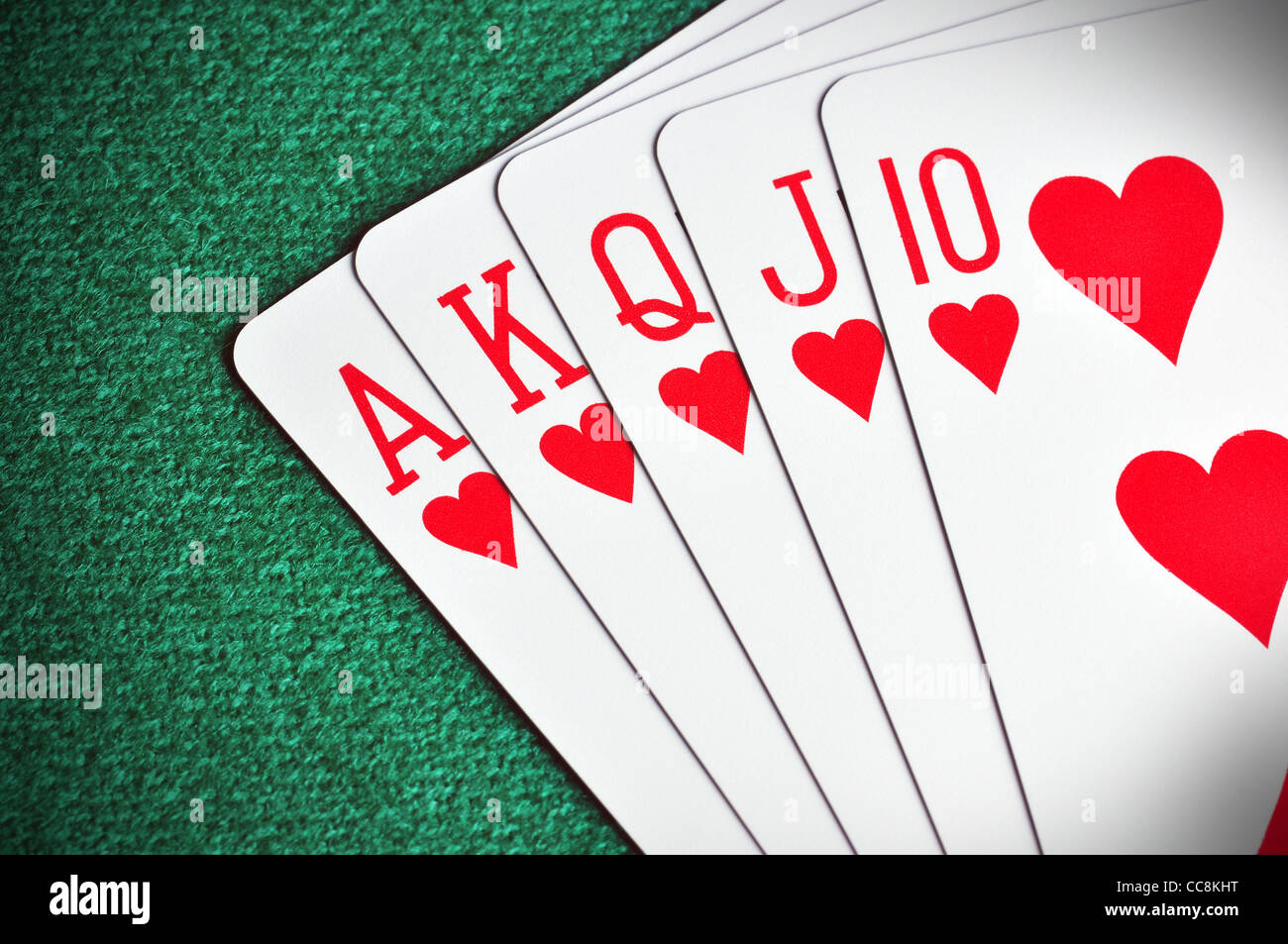 Royal Flush poker card sequence on a green table - Stock Image