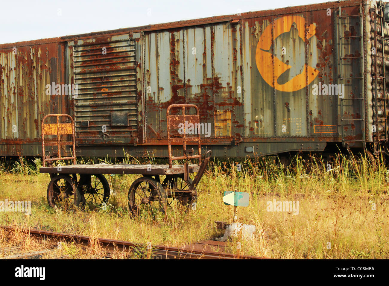 Baggage cart and freight car. - Stock Image
