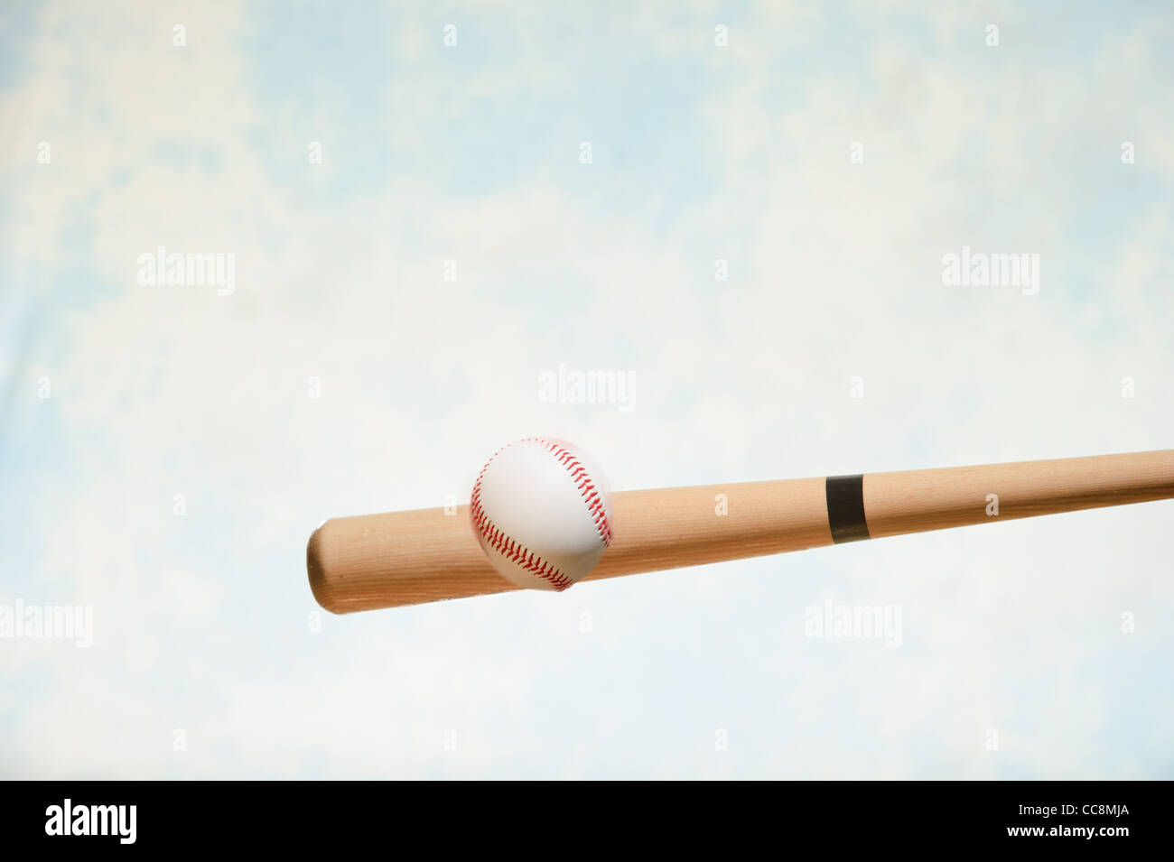 Enjoying a game of baseball - Stock Image
