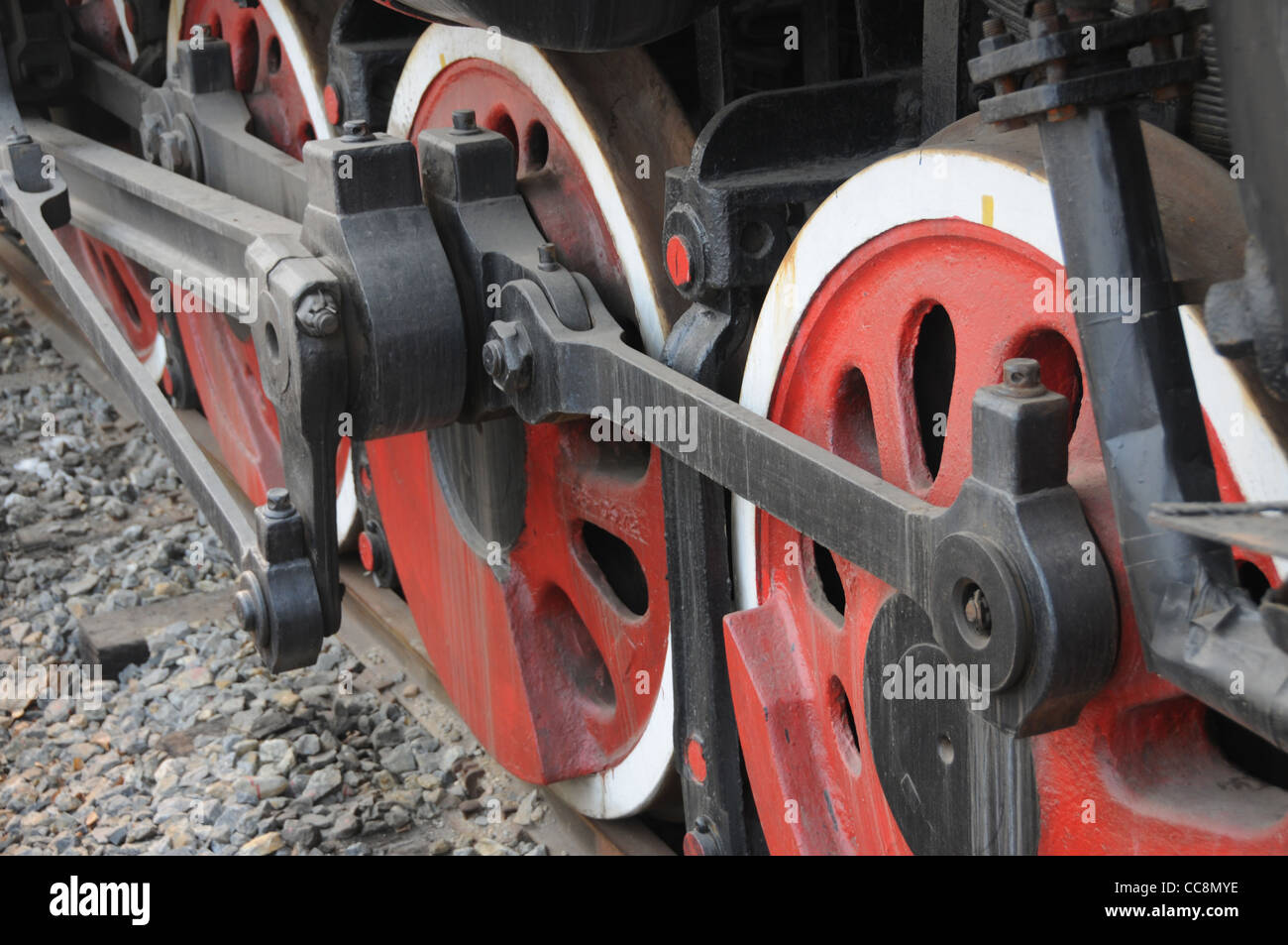 Wheels and connecting rod assemblies on chinese steam locomotive - Stock Image