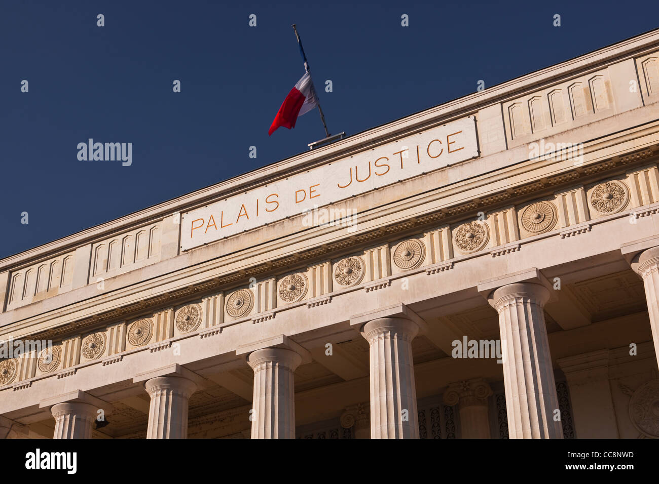 The french flag flying over the court house in Tours, France - Stock Image