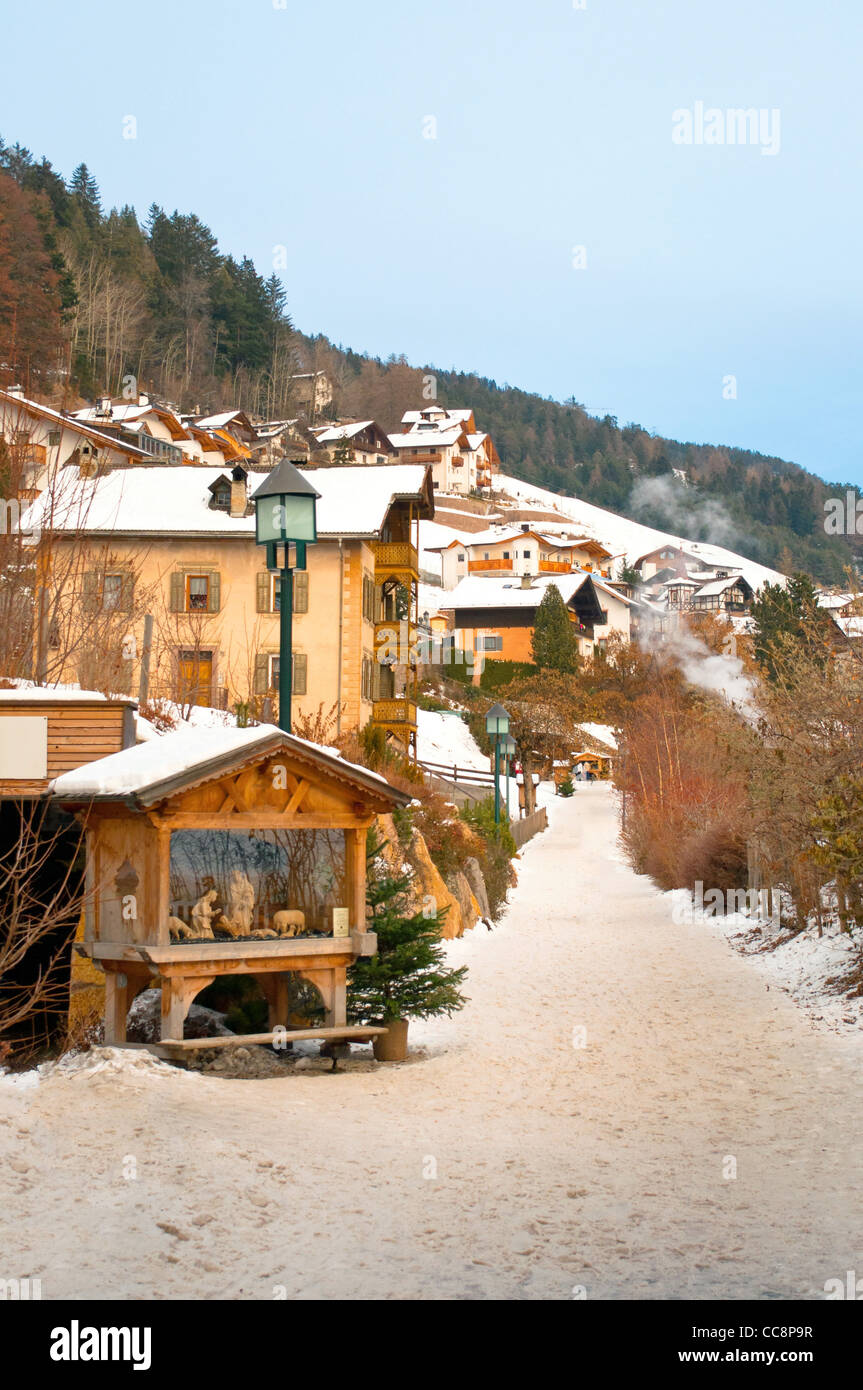 Ortisei town in winter time, a walkway path - Stock Image