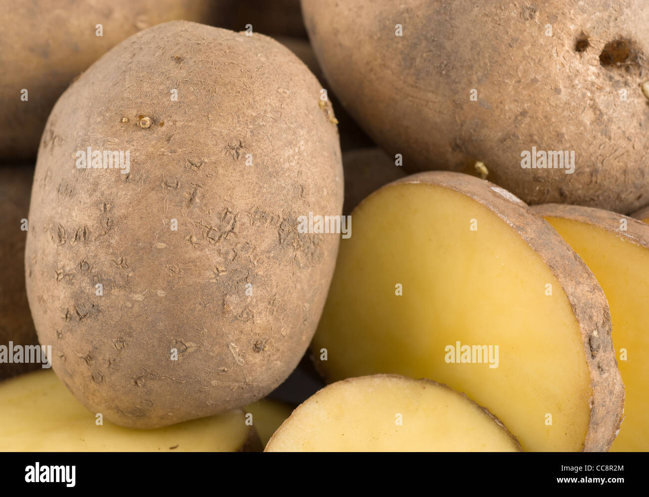 A large group of objects raw potatoes - Stock Image