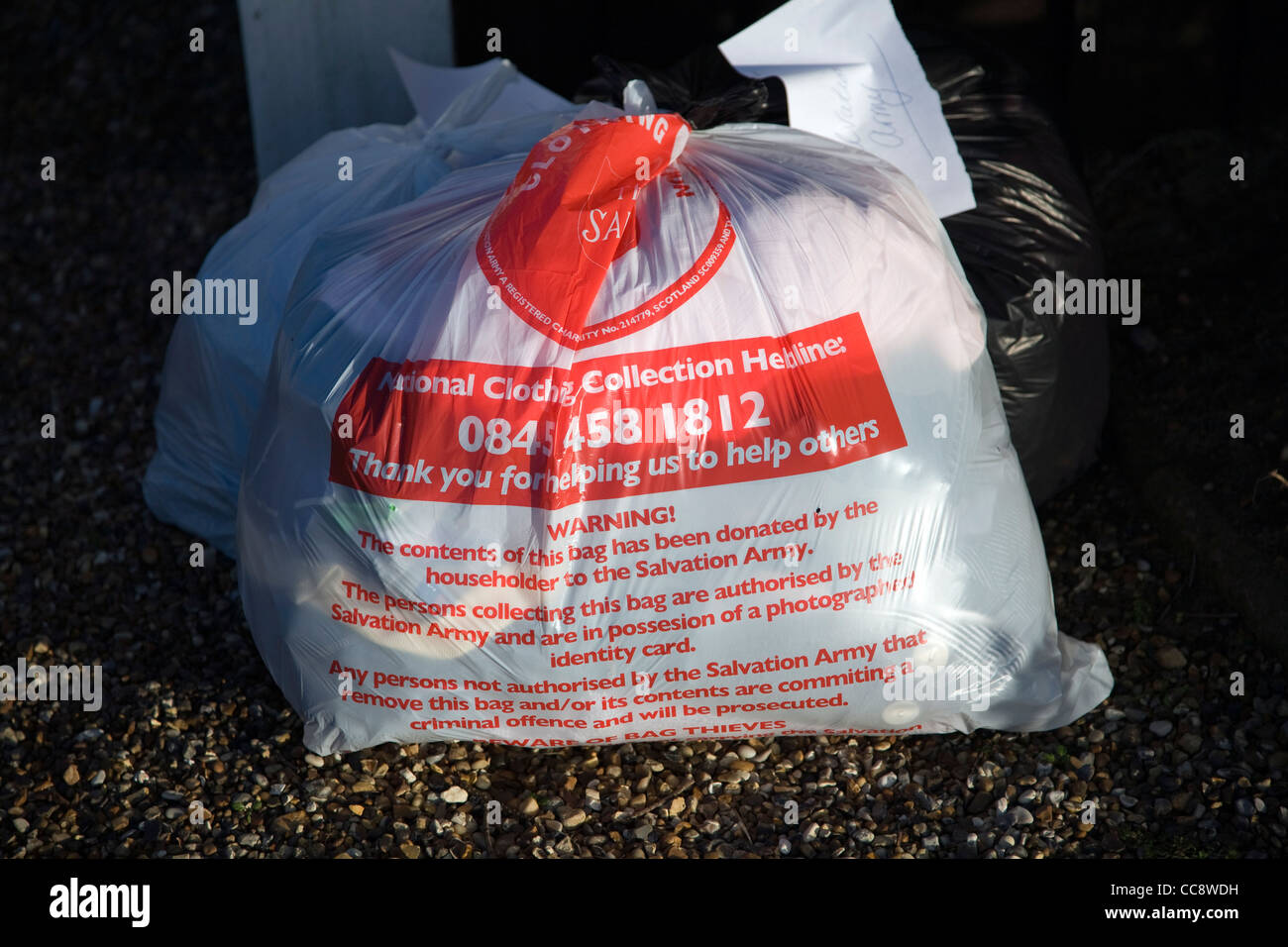 Charity clothes donations collection plastic bags - Stock Image