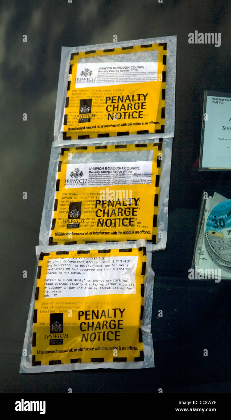 Three penalty charge notices car windscreen - Stock Image