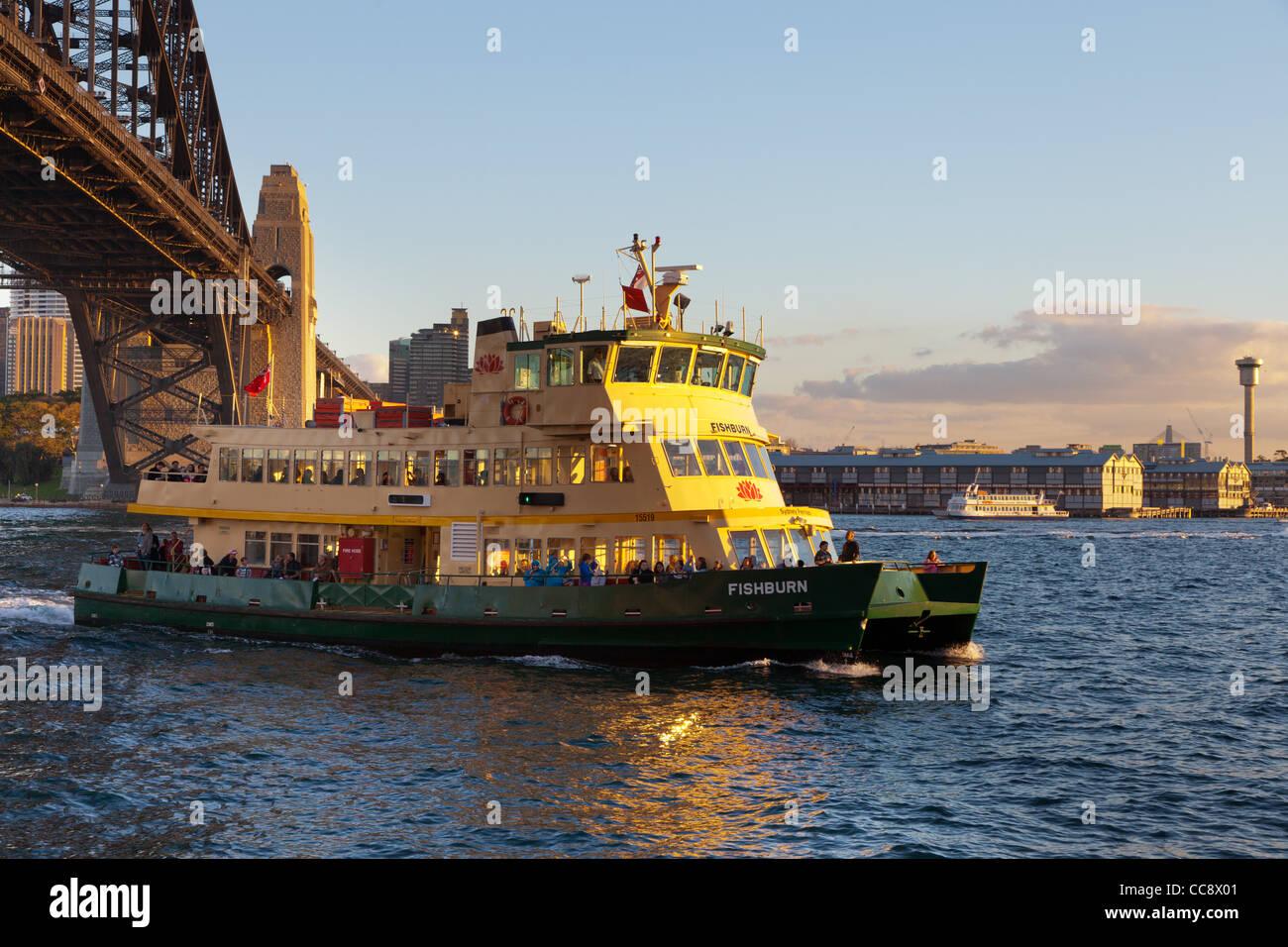 Green and gold ferry near Kirribilli Sydney - Stock Image