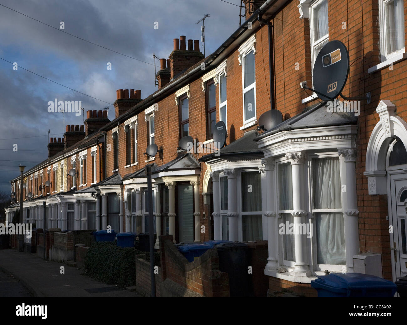 TV satellite dishes on row terraced housing Ipswich - Stock Image