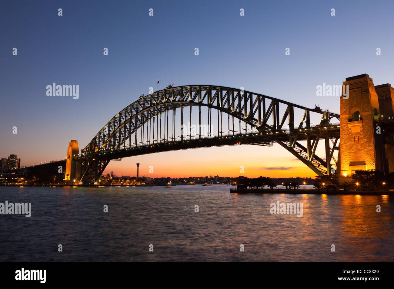 Sydney Harbour Bridge from Kirribilli at dusk - Stock Image