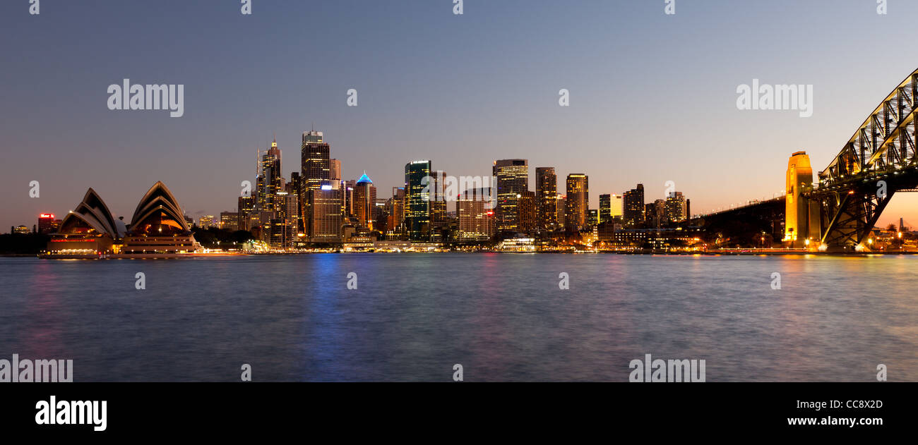 Sydney CBD skyline from Kirribilli with the Opera House and Harbour Bridge at dusk - Stock Image