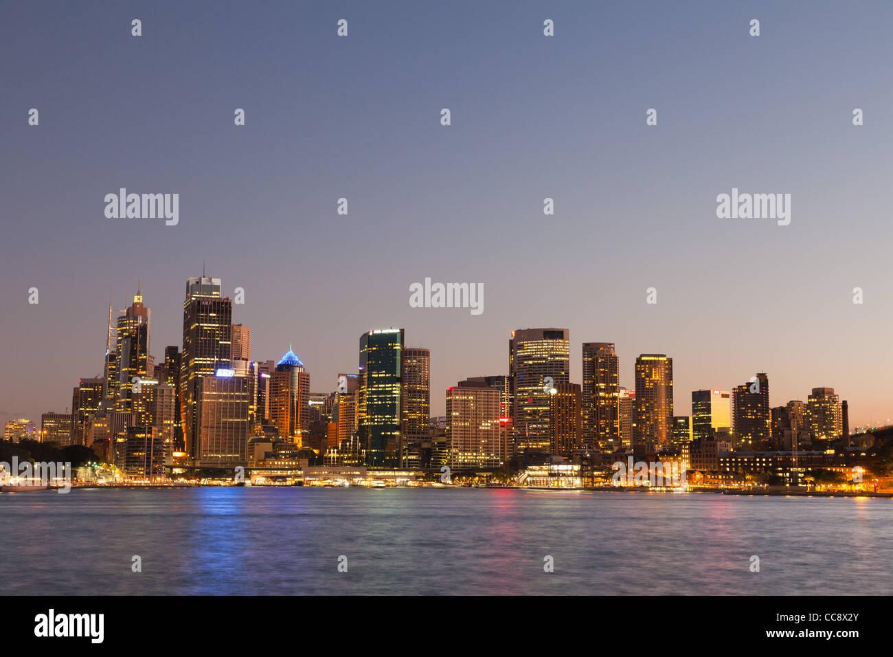 Sydney city skyline from Kirribilli  at dusk - Stock Image
