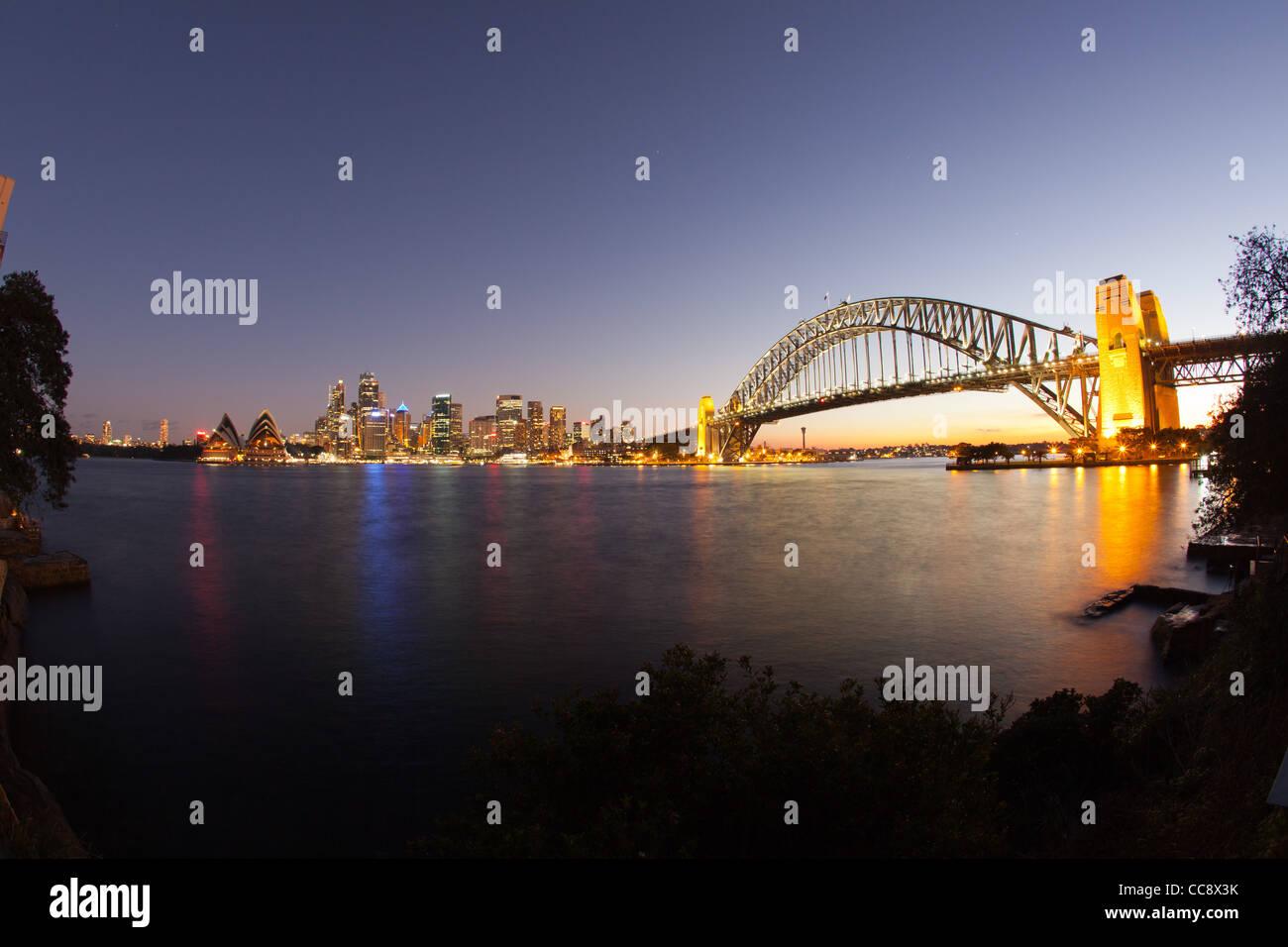Sydney Harbour Bridge and city skyline from Kirribilli  at night - Stock Image