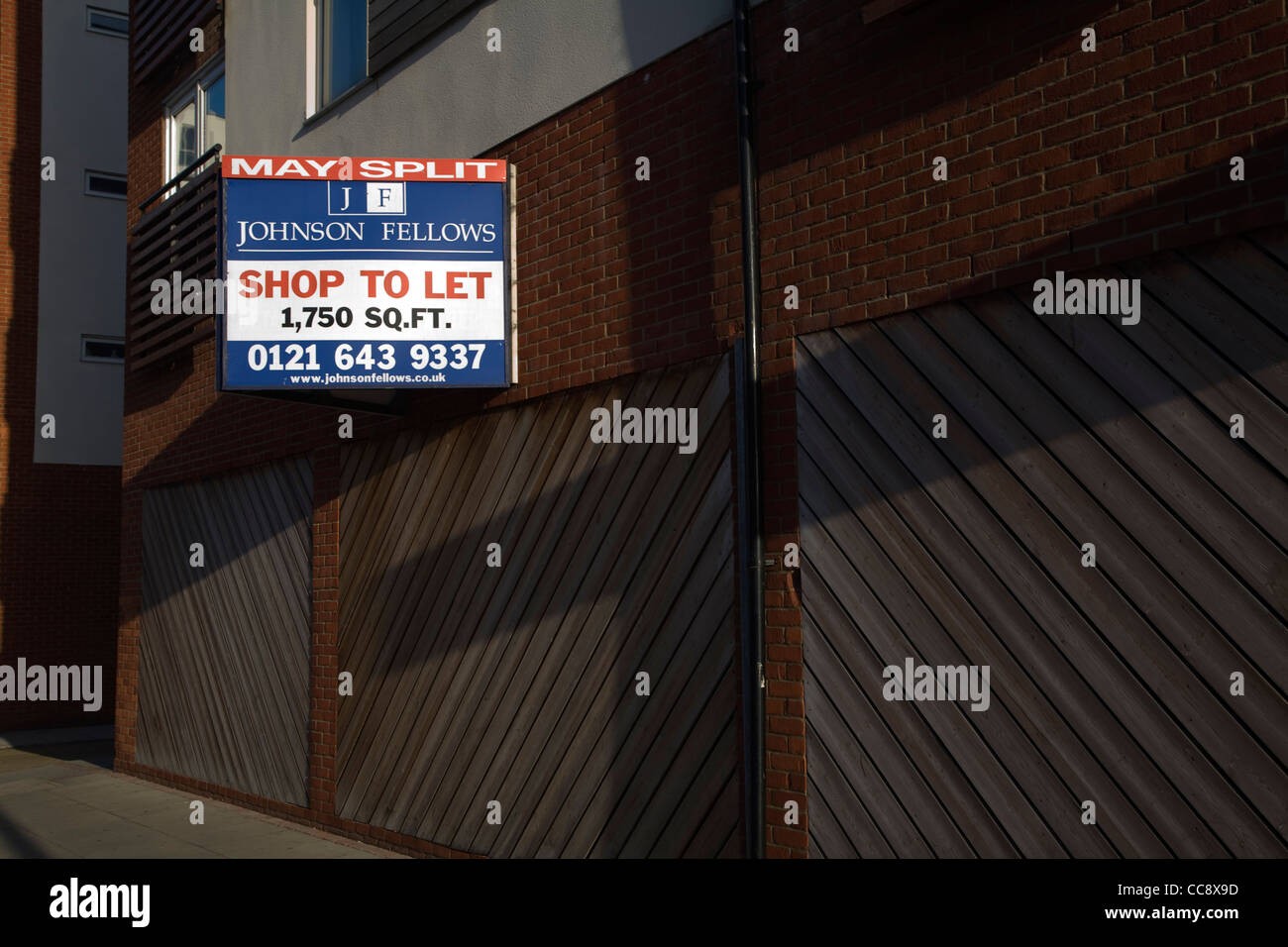 Commercial property shop units to let estate agent sign - Stock Image