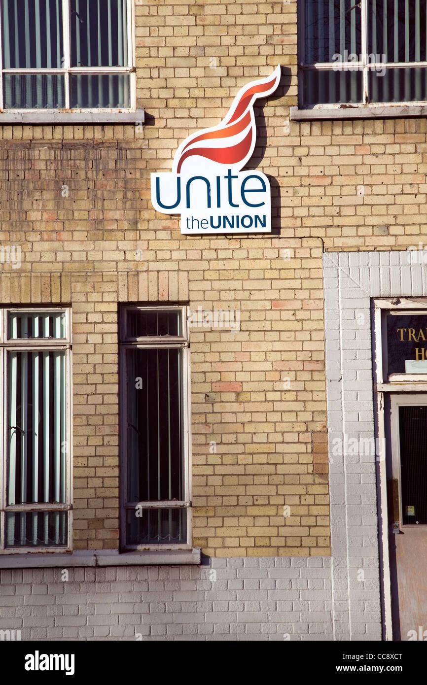 Unite the Union flame logo on building - Stock Image