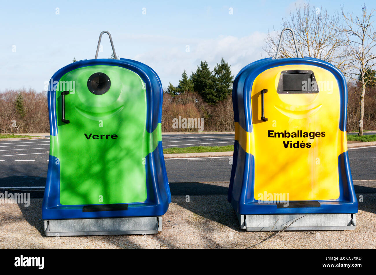 Two French recycling bins, for glass bottles and empty packaging. Stock Photo