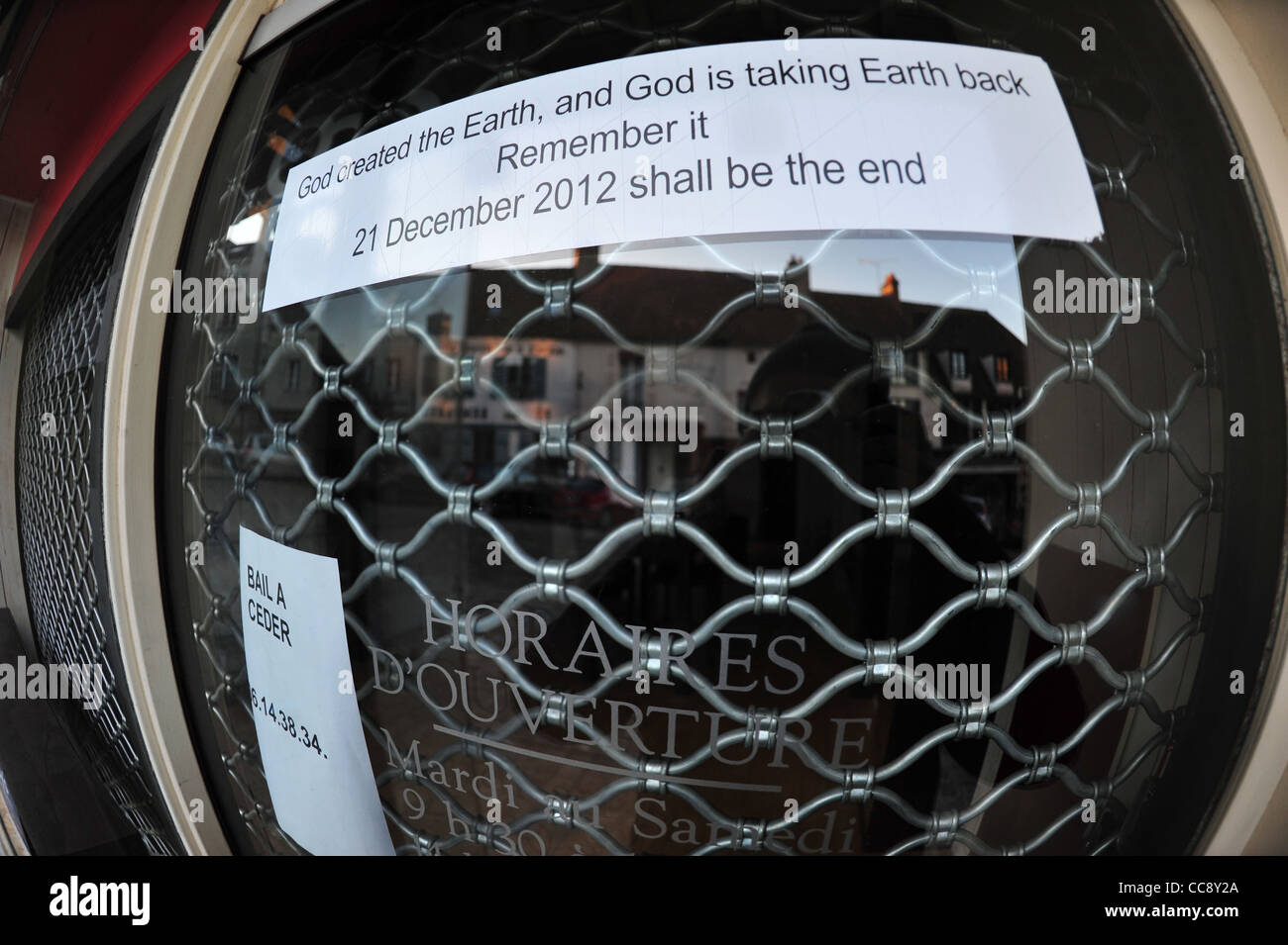 God created the Earth and God is taking Earth back 21 December 2012 shall be the end. Unwanted sticker, taken with - Stock Image