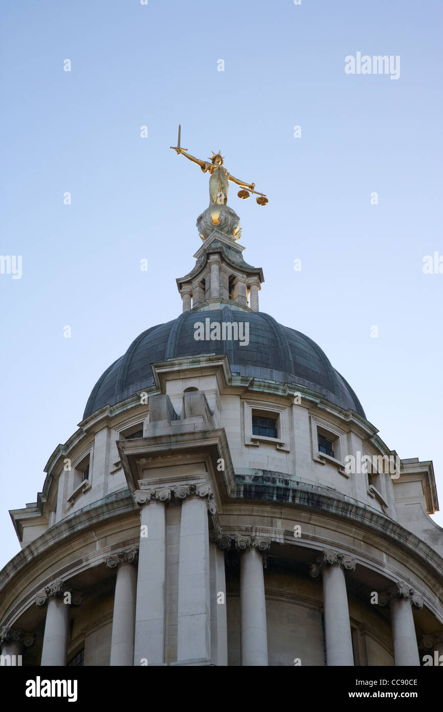 justice statue on top of the dome of the old bailey London England UK United kingdom - Stock Image