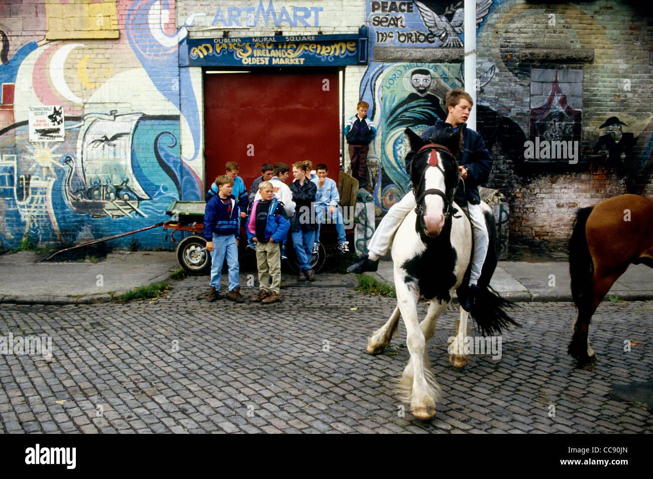 Boys show off their skills with ponies in Dublin's Smithfield Market -Ireland - Stock Image