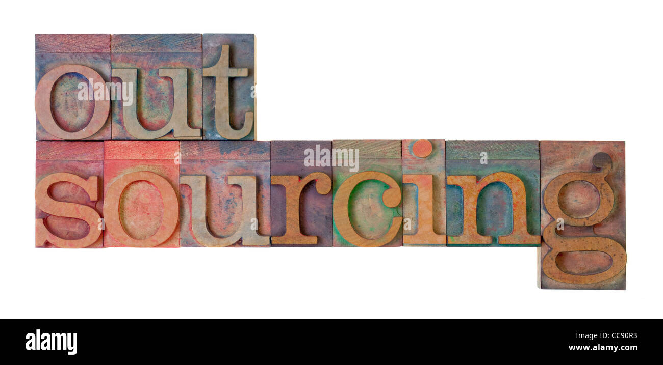 outsourcing word in vintage wood letterpress type blocks, stained by color ink, isolated on white - Stock Image