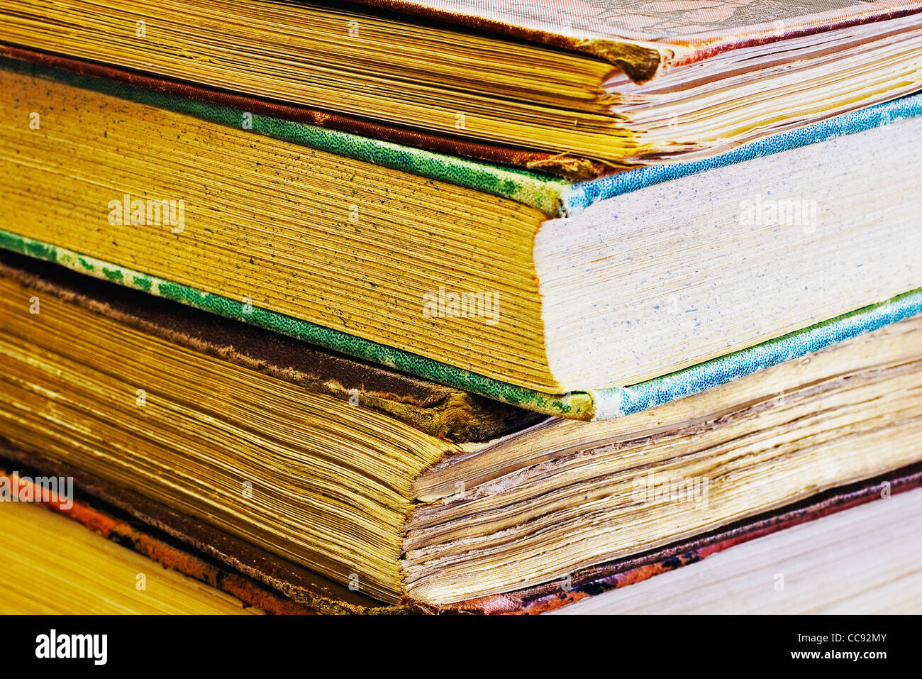 stacked collection of old books - Stock Image
