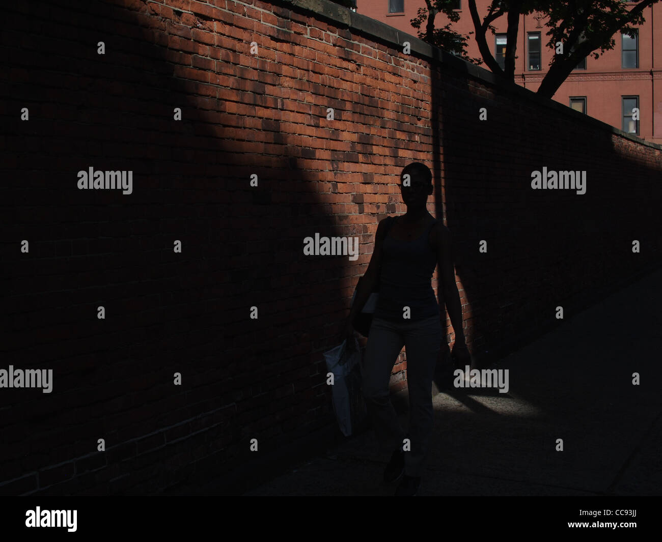 Superior New York City Light And Shadow, Woman Walks Past Catholic Church Wall In  Little Italy Area Nice Look