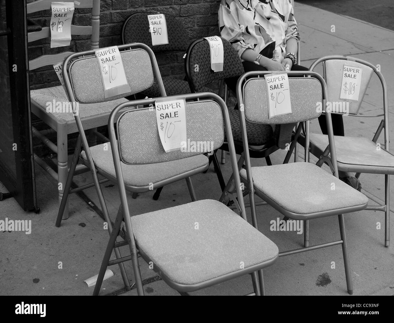 Chairs for sale outside secondhand store, Brooklyn, New York - Stock Image