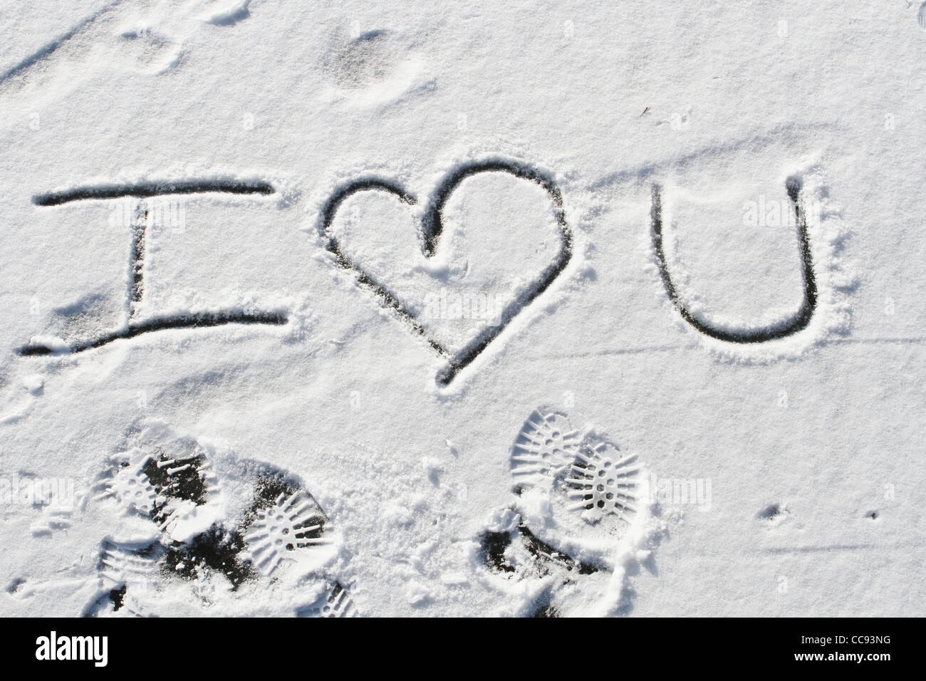 I (heart) you written in snow. - Stock Image